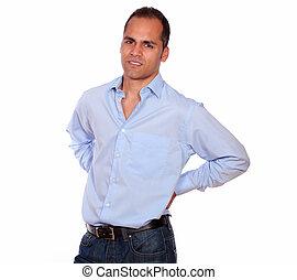 Hispanic adult man with back pain
