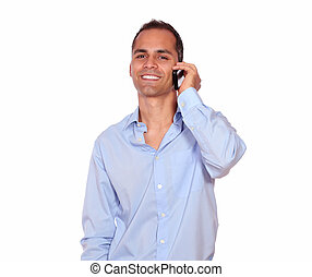 Smiling adult man speaking on cellphone