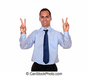 Smiling adult man showing you victory sign