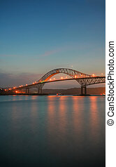 The TransAmerica Bridge in Panama City at sunset