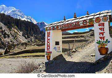 Entrance gate with welcome sign, Manang, Nepal - Entrance...