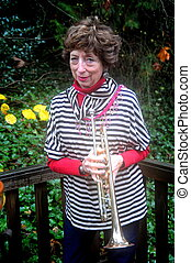 Female trumpet player. - Female trumpet player with her...