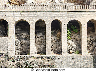 Arches in Pompeii - Ancient arches in a wall in the ruins of...
