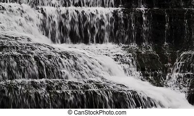Cascading Water Loop - Water falls over rock ledges in this...