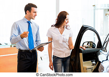 Consultant in the showroom and the buyer - car salesman...