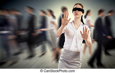 young blindfolded woman. seeking a way out in a crowd