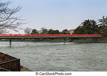 A red bridge over water Japan