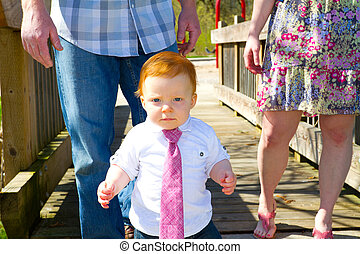 Little Guy Wearing A Tie - A baby wearing a red or pink...