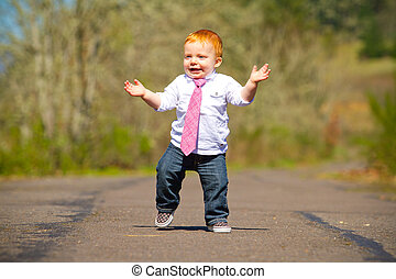 Baby First Steps - A one year old boy taking some of his...
