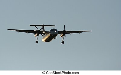 Final Approach - Propeller plane on its final approach to...