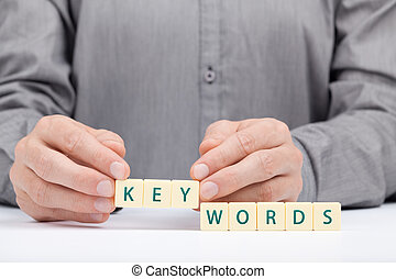 Keywords concept. Man complete word keywords.