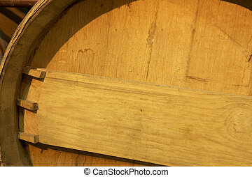 Wine barrel detail in an aging process cellar