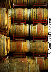 Wine barrels in an aging process at spanish cellar vertical