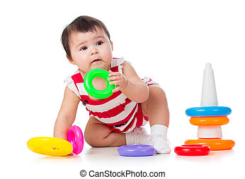 toddler girl playing with pyramid toy