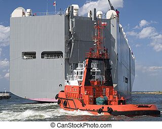 Huge Vessel - A tugboat assisting huge vessel