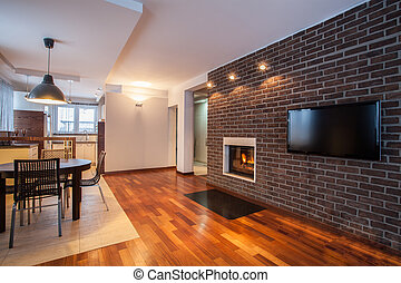 Country home - dining room with brick wall and fireplace