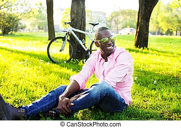 Young happy smiling african american wearing sunglasses with...