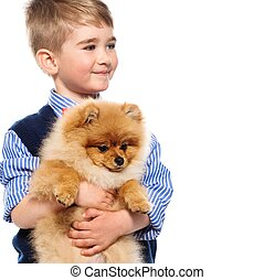 Little happy boy holding spitz