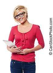 Smiling woman with glasses holding digital tablet