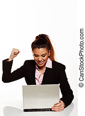 Frustrated woman punching her laptop