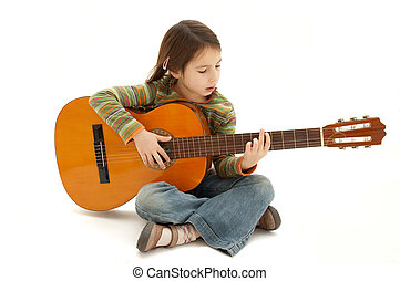 young girl playing acoustic guitar isolated on white...