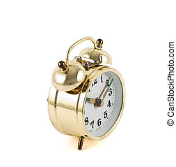 Golden mechanical alarm clock isolated - Traditional wind-up...