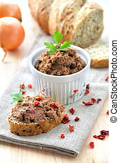 Liver pate with paprika with slices of wholegrain bread