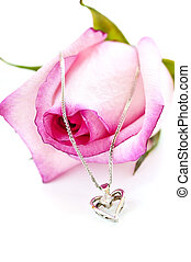 Diamond necklace on rose