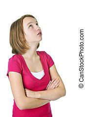 Teenage girl looking up - Teenage girl rolling her eyes in...