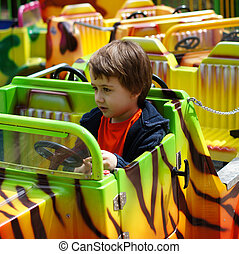 Boy is driving toy train - Little boy is driving toy train...