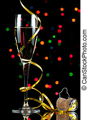 champagne flute with reflection and colored lights