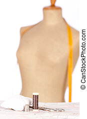 taylor mannequin with tape measure isolated on white