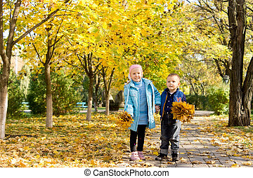 Brother and sister in autumn park