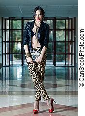 Young beautiful woman wearing leopard pants