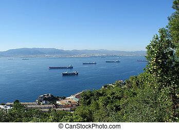 Gibraltar harbor - cargo ships in between Gibraltar and...
