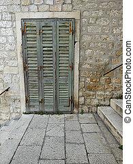 Old green shutter door