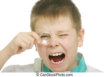 Shocked by seen - Boy looking to magnifying glass and...