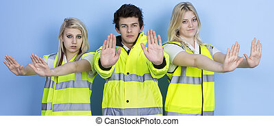 Serious Man And Woman Wearing High-visibility Jacket Showing...