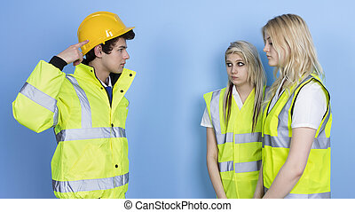 Man Shouting To Female Worker For Not Wearing Hard Hat Over...