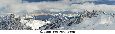 Dramatic Panorama of Snow Capped Mountain Peaks in the...