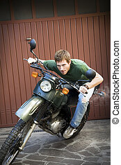 motorbike - Portrait of young man driving vintage motorbike