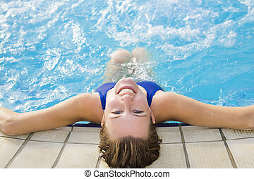 spa - Portrait of young woman sitting in swimming pool, rear...