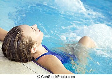 spa - Portrait of young woman sitting in swimming pool