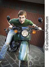 motorbike - Portrait of young man sitting on motorbike