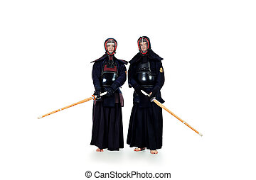 hakama sword - Two kendo fighters posing together over white...