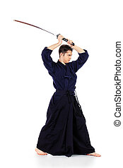 kimono clothing - Handsome young man practicing kendo....