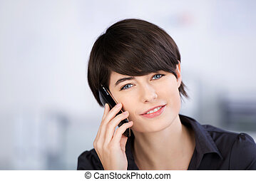 Woman telephoning with her smartphone