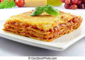 lasagna bolognese - fresh lasagna with basil on top