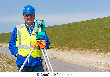 Engineer and Total station or theod - Engineer working with...