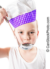 Child boy cook wearing a chef hat with pan isolated on white background.The concept of healthy food and childhood